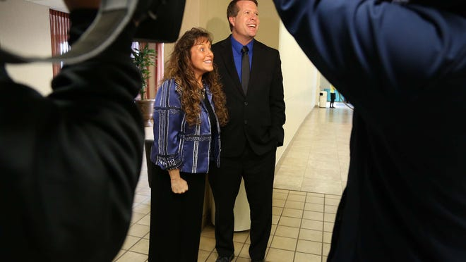 Michelle and Jim Bob Duggar, reality television stars known with members of the media before participating in a roundtable discussion about education on Thursday, April 9, 2015 at the Des Moines Airport Holiday Inn.
