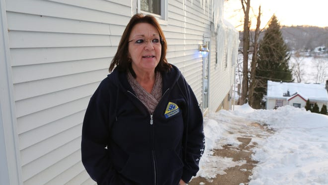 Roseanne Di Guilio stands Feb. 10, 2015 in front of her home that straddles the New York and Connecticut state line. She lost half if it in a tax foreclosure by Putnam county.