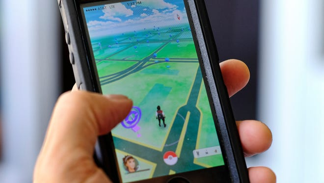 Pokémon Go is displayed on a cell phone.