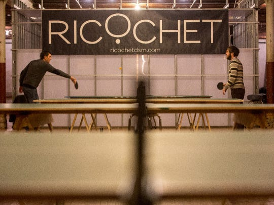 Patrons play a game of table tennis at the new Ricochet game lounge in the East Village.