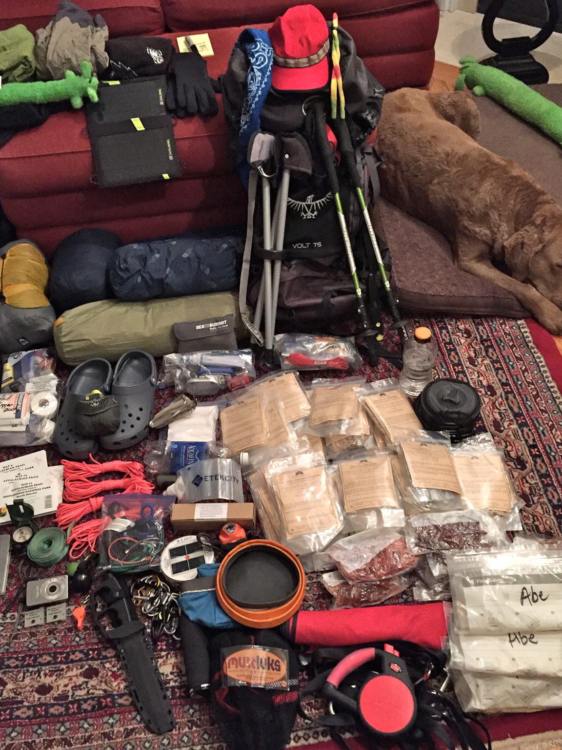 David Paulk unpacks his backpack to organize and eliminate some items to reduce weight for his hiking trip.