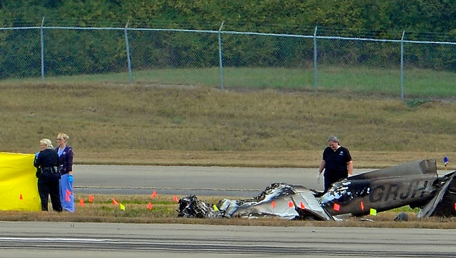 Emergency personnel investigate a small airplane crash at the Nashville airport on Oct. 29, 2013.