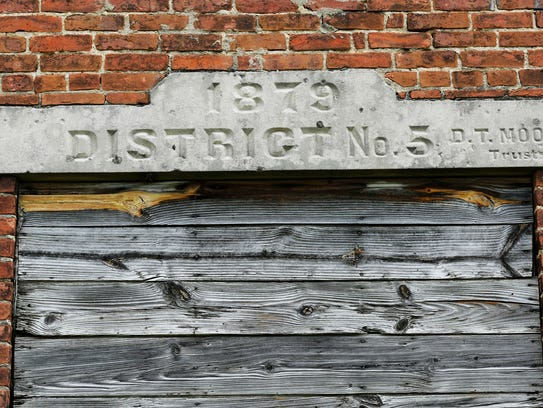 Marker above the front door of the old Morris School,