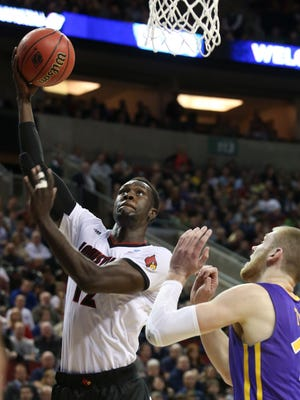 U of L's Mangok Mathiang, #12, shoots against Northern Iowa's Seth Tuttle, #10, at the KeyArena in Seattle during the third round of the NCAA tournament.March 22, 2015
