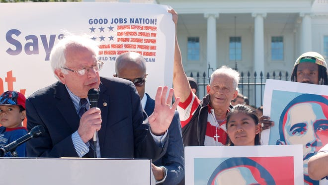 Sen. Bernie Sanders, I-VT, speaks at a rally in September, 2013, in front of the White House for government contract workers as part of a one-day strike for better wages.