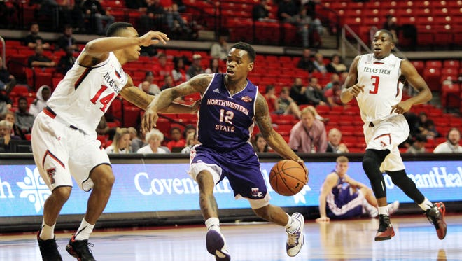 Northwestern State Demons guard Jalan West (12) works the ball against Texas Tech Red Raiders guard Robert Turner (14) in the first half at United Supermarkets Arena.