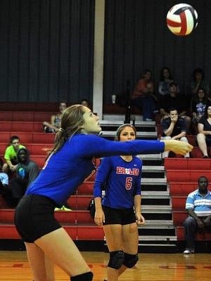 Evangel's Ellie DuBois sets the ball in a game this fall.
