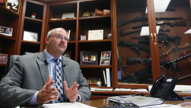 During a news conference in his office Greene County Sheriff Jim Arnott discusses the president's executive action to widen gun background checks on Tuesday, Jan. 5, 2015. Sheriff Arnott encouraged responsible gun ownership, but didn't agree with the president's executive action.