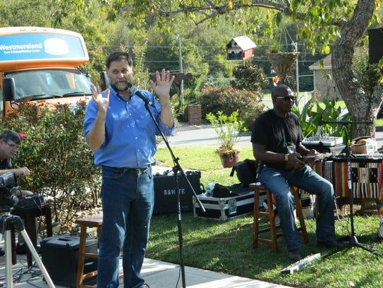 Dr. Bill Thomas, left, accompanied by Ugandan musician
