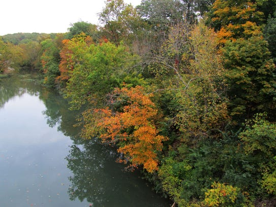 Trees are aglow with color along the James River Water