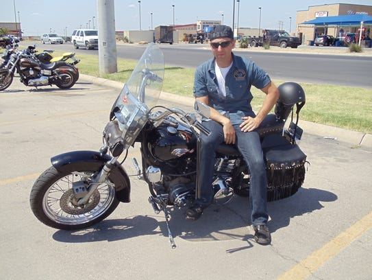 Donald Di Pietro relaxes on his dad's 1976 Harley-Davidson
