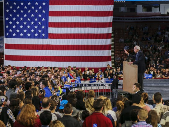 Bernie Sanders participates in  a campaign rally at