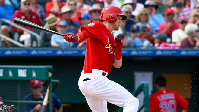 St. Louis Cardinals left fielder Jeremy Hazelbaker connects for a base hit against the Boston Red Sox during the game Mar. 21 at Roger Dean Stadium.