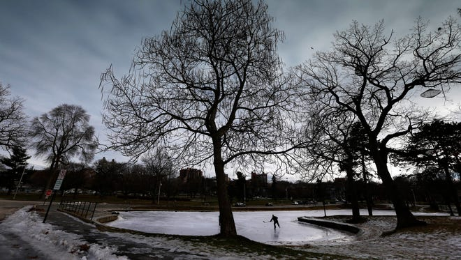 Wayne Twombley chases after a hockey puck while skating at Deering Oaks Park on Dec. 28, 2016, in Portland, Maine. Weather more favorable to skiers will move in on Thursday as a winter storm is expected to dump about six inches of snow in Portland.