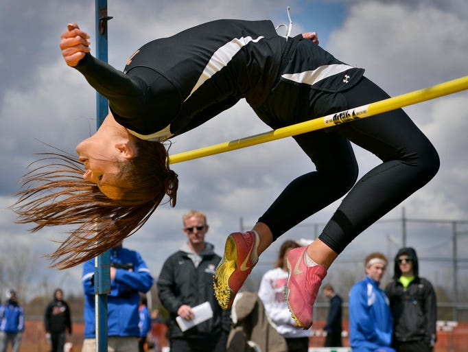 St. Cloud Tech junior Megan Parries arches to clear the bar at 4 feet 10 inches Saturday, May 3 in the high jump during the Sauk Rapids Mega Meet.