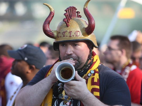 Detroit City FC fan Vytautas Malesh plays his horn on the way to the game against Milwaukee Torrent on Friday, May 12, 2017 at Keyworth Stadium in Hamtramck.