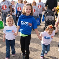 "Fisher Armstrong, 7, of Fairview, will be walking in the JDRF One Walk Sunday, at McCormick Field, with his team, ""Fisher's Future."""