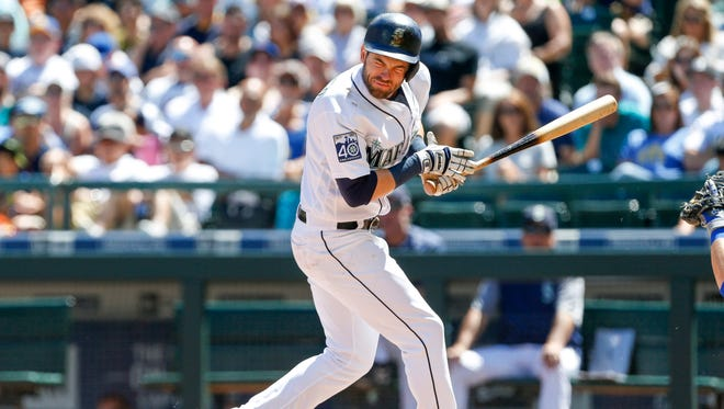 Seattle Mariners right fielder Mitch Haniger reacts after being hit in the face by a pitch against the New York Mets during the second inning of Saturday's game at Safeco Field.