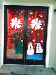 The door of Bella Luci Salon is painted for the holiday