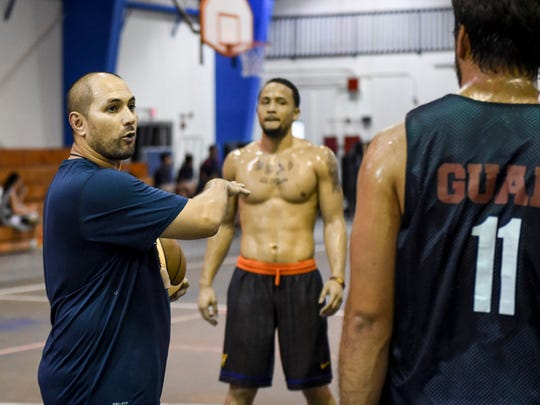 Guam Men's National Basketball Team coach EJ Calvo sets up a full-court-press drill during practice at the Jose Rios Middle School gym in Piti on May 27. Mark Scott/Pacific Daily News/mscott5@guampdn.com