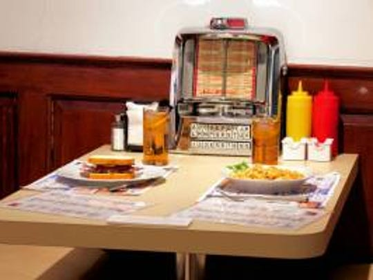Exhibit of a diner table with jukebox at the Cornelius Low House Museum in Piscataway.