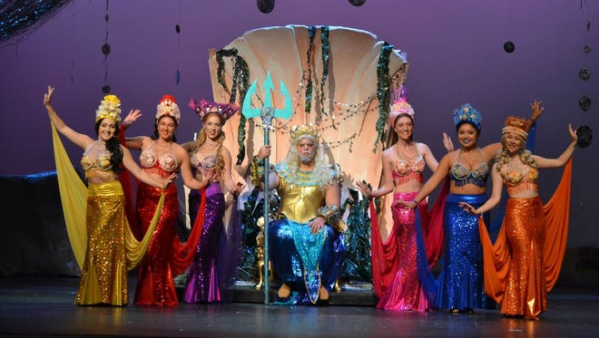 """Rocco Barbera as King Triton (seated) and the meresisters (standing, from left) Victoria Cox, Abigail Hunt, Caitlin Geisser, Laura Frye, Alyssa Lopez and Mikaela Simon rehearse a scene from the Off Broad Street Players' production of """"The Little Mermaid."""""""
