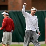 Alabama offensive coordinator/quarterbacks coach Lane KiffIn works with the passing game during the Crimson Tide's practice on Wednesday in Tuscaloosa.