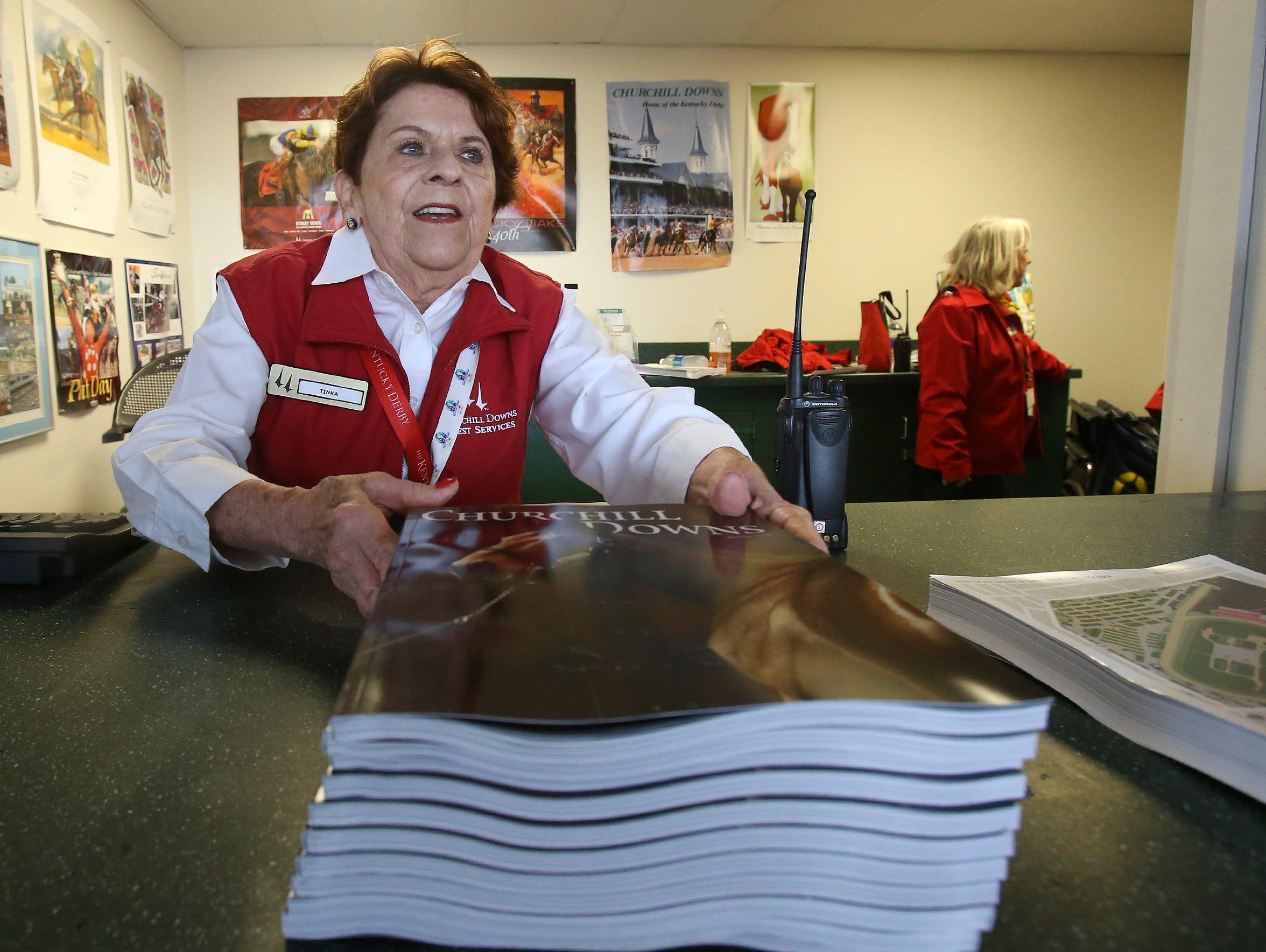 Guest services team member Tinka Tingle displays literature