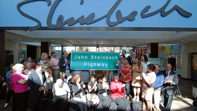 "In a ceremony on Monday at the National Steinbeck Center, Assemblymember Luis Alejo led the unveiling of a life-size highway sign designating sections of Highway 101 as ""John Steinbeck Highway."""