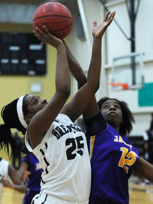 Brew Tech's Michaia Fluellen (25) is defended by Jackson's Montiara Cox (12) at the Brew Tech campus in Montgomery, Ala. on Monday February 9, 2015.