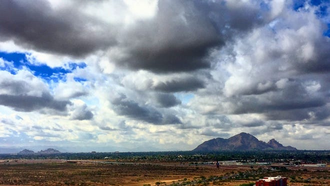Clouds roll over Camelback Mountain on Nov. 28, 2016, in this view from Talking Stick Resort near Scottsdale.