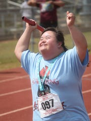 Mary Moore, short-distance runner from Dededo, gives her all in the anchor leg of the 4x100 relay during the 40th annual Special Olympics Guam Track and Field Event at Okkodo High School on March 19, 2016.