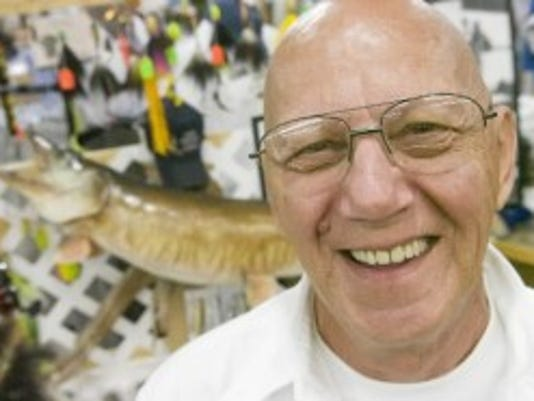 Lee Snyder of Dover stands at Gander Mountain in 2008, in front of the 53.5-inch muskee he caught in 1986. (File photo)