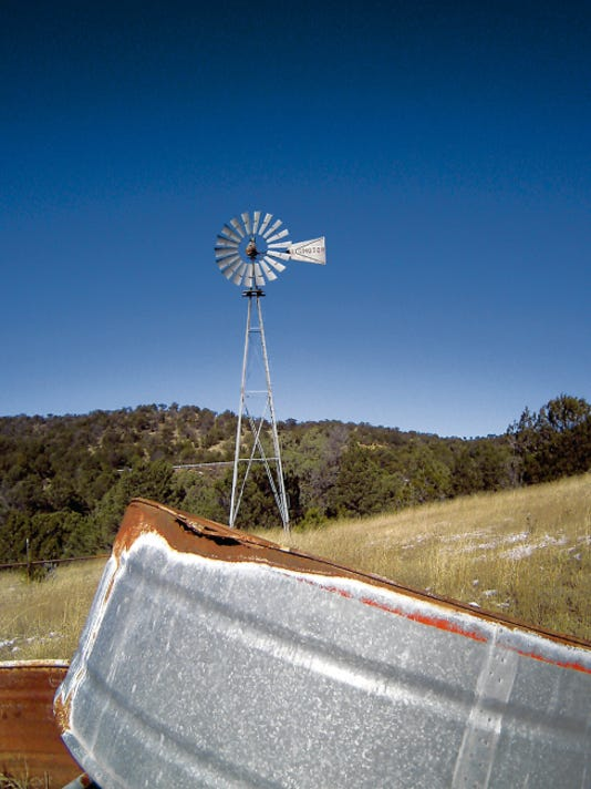 This windmill and tank form landmarks for hikers following the path of the former Capitan-Carrizozo railroad spur.