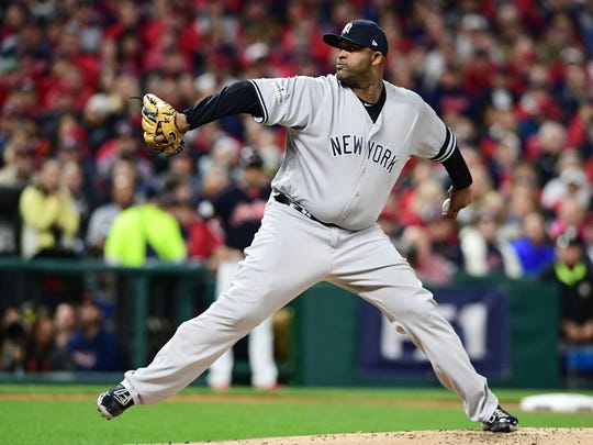 New York Yankees starting pitcher CC Sabathia delivers during the first inning against the Cleveland Indians in Game 5 of baseball's American League Division Series, Wednesday, Oct. 11, 2017, in Cleveland.