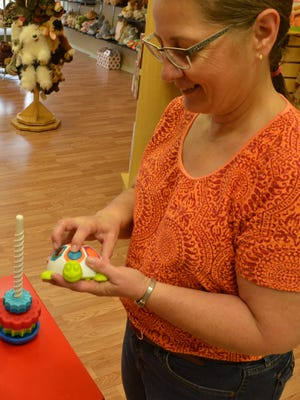 Trish Terry of Hall of Toys shows off a toy that will be at the Developmental Fun Toy Demonstration.