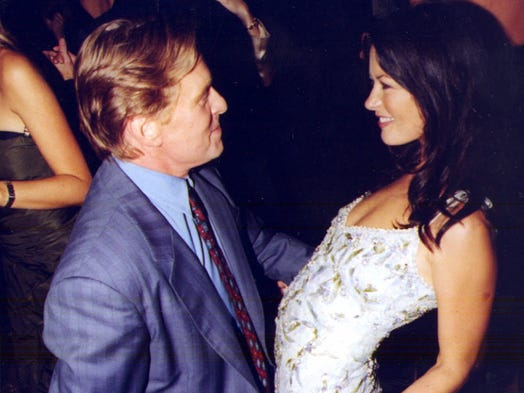 After almost 13 years together, actors  Michael Douglas, 68, and Catherine Zeta-Jones, 43, are splitting. USA TODAY takes a look at their relationship, in photos. This shot shows the happy couple getting down at their mutual birthday party in 1999.