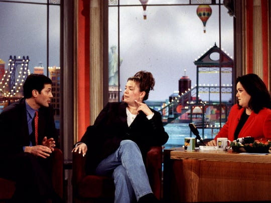 Tom Valenti, left, managing partner of The Palisades Center in West Nyack, talks to Jamie Hand, center, manager of the mall's Ultra Beauty Salon, and talk show host Rosie O'Donnell on her program, in New York Thursday Jan. 7, 1999. O'Donnell told her national audience on an earlier program about rumors that the mall was sinking. Valenti brought evidence from surveyors and structural engineers declaring the mall safe, while Hand argued that she has seen cracks in the mall's floor and believes she has felt the floor shake. (AP Photo/Ray Amati, Warner Bros.)