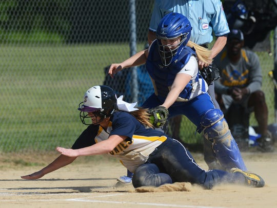Northampton catcher Cassie Nadeau tags out Chincoteague's Kristin Fox as she attempts to slide into home during their softball game in Eastville, Va. on Monday, May 16, 2016. Chincoteague won the game 19-3.