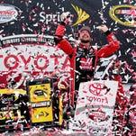 Kurt Busch celebrates Sunday after winning the Sprint Cup Series Toyota Owners 400 at Richmond International Raceway.