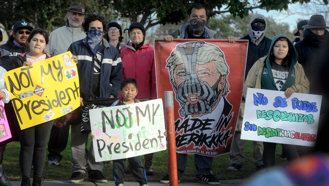 Protesters at Del Sol Park in Oxnard spoke out against the newly elected President Donald Trump on inauguration day. Since the election, many are anxious over Trump's immigration policies.