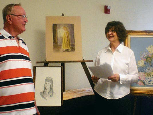 Don Brashear and Carolyn Gaulden prepare for the Christian Art Show set for Sunday at First Baptist Church.