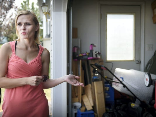 Beate Sutton stands at the garage of her house at 314 Shepherd St. in Union Township that was destroyed when her estranged husband, Matthew Sutton, held state police at bay for nine hours on Aug. 27. Police flooded the two-story house with tear gas so that they could enter and take Sutton into custody.