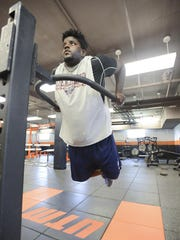 Damani Taylor, a football player at UTM, exercises