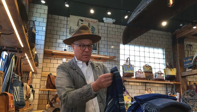 Will Adler, the founder of Will Leather Goods, shows off shows off some of the items that will be on sale at the new Midtown shop on Monday, Nov. 2, 2015.