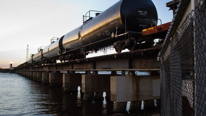 A freight train heads north on the Florida East Coast Railway train trestle on June 15, 2015, with tanks of unmarked substances over the St. Lucie River in Stuart.