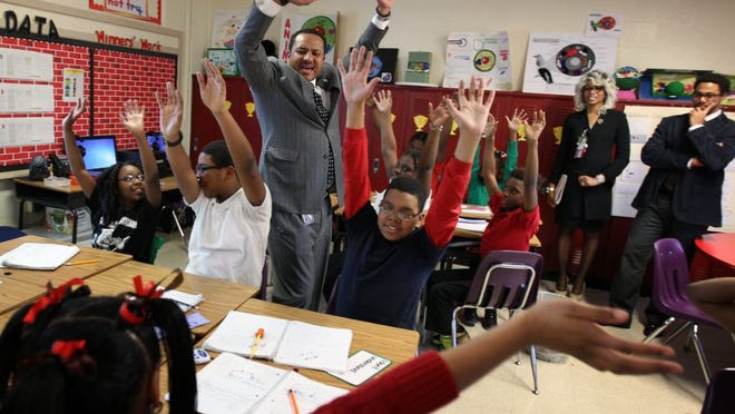 January 13, 2016 - Cherokee Elementary science teacher Roland Woodson gets his fifth-grade class involved and energized while teaching. Administrators from the District of Columbia Public Schools were in Memphis to observe the practices at Shelby County Schools' I-Zone school to borrow practices that have lead to sharp gains for their take back to their district.
