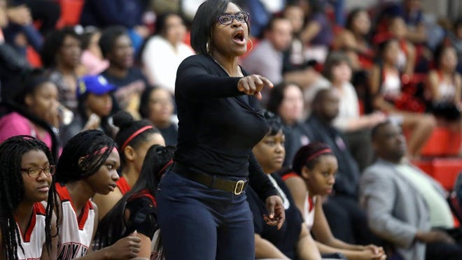 GABE HERNANDEZ/CALLER-TIMES West Oso coach Cheryl Fillmore directed her players to a 34-21 win over Rockport-Fulton Tuesday night, giving the Bears sole possession of the District 31-4A lead.