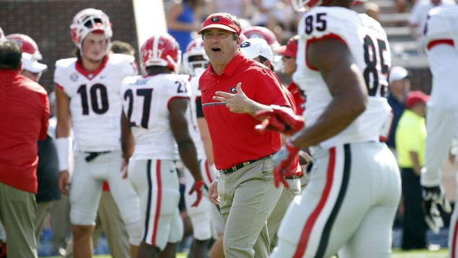 Georgia head coach Kirby Smart calls out to players before the Bulldogs game against Ole Miss on Sept. 24, 2016, in Oxford, Miss. The Rebels won,  45-14.