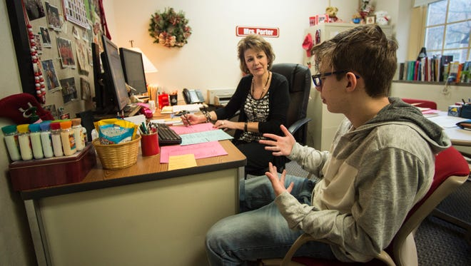 Richmond High School counselor Sally Porter speaks to a student in her office on Thursday, Jan. 26, 2017.